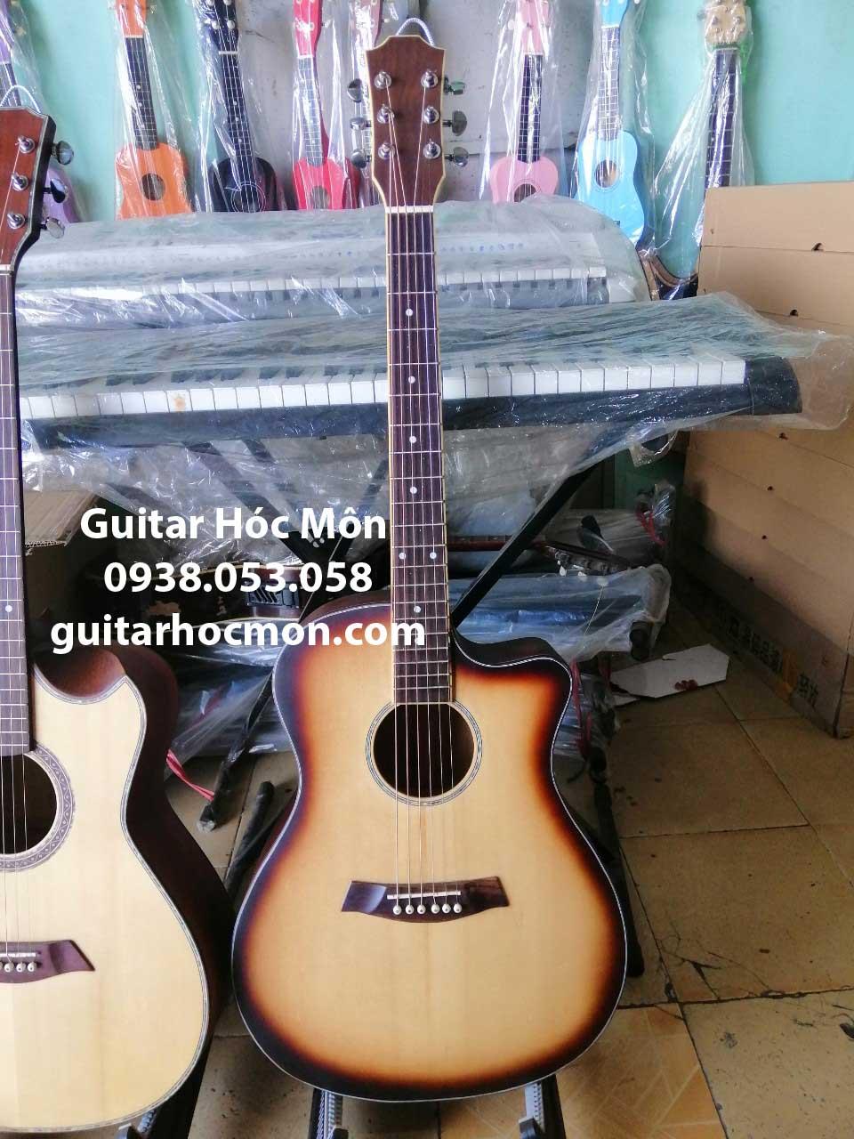 Đàn guitar gỗ điệp